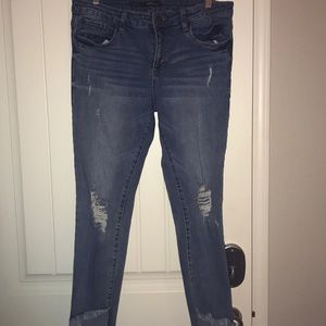Distressed frayed-hem ankle jeans
